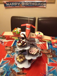 As delivered by his Planes cakestand. Some different cupcake toppings.